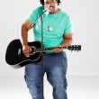 Overweight african american man with guitar singing — Stock Photo