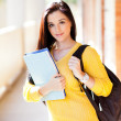 Female university student with books and backpack — Stock Photo