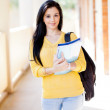 Female university student walking down corridor — Stock Photo #11939663