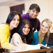 Group of college students using laptop — Stock Photo #11939783