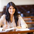 College girl in lecture hall — Stock Photo