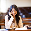 Female university student talking on cell phone — Stock Photo