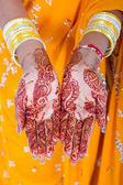 Indian woman hands with henna — Stock Photo
