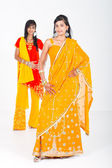Young indian women in traditional sari in studio — Stock Photo