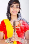 Young indian woman holding incense — Stock Photo
