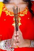 Closeup of indian woman with incense — Stockfoto