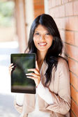 Female university student holding a tablet computer — Stock Photo
