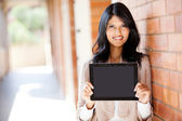 Female college student presenting a tablet computer — Stock Photo