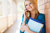 Female college student talking on mobile phone — Stock Photo