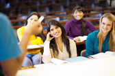 College professor leccturing group of students — Stock Photo