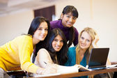 Group of college students using laptop — Stock Photo