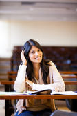 Female university student in lecture hall — Stock Photo
