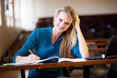 Happy college student in classroom — Stock Photo