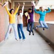 Group of college students jumping — Stock Photo