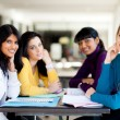 Group college students sitting by cafeteria — Stock Photo