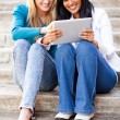 Friends using tablet computer together — Stock Photo