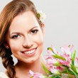Beautiful young woman with a bouquet of flowers — Foto de Stock