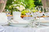Beautifully served table in a summer pavilion — Stock Photo