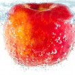 Stock Photo: Ripe red apple with bubbles underwater