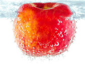 Ripe red apple with bubbles underwater — Stock Photo