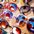 Stock Photo: Rack with assortment of sunglasses