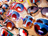Rack with an assortment of sunglasses — Stock Photo