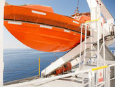 Orange lifeboat on deck of cruise ship — Stock Photo