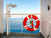 Red life buoy on the rail of a liner — Stock Photo