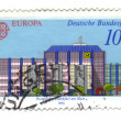 GERMANY - CIRCA 1990: A stamp printed in Germany, shows Post Off - Stock Photo