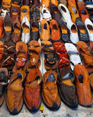 Shoes for sale on a tunisian street — Stock Photo