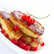 Pancakes with red currants — Stock Photo