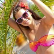 Tanned girl near palm trees — Stock Photo #11899169