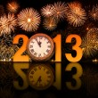 Stock Photo: 2013 year with fireworks and clock displaying 5 minutes before m