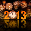 图库照片: 2013 year with fireworks and clock displaying 5 minutes before m