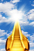Golden escalator stairs to the shine in the sky — Stock Photo