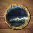 Stock Photo: Ship porthole with storm outside