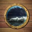 Ship porthole with storm outside — Stock Photo