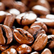 Fried or roasted coffee beans macro — Stock Photo