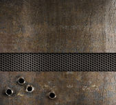 Bullet holes in metal background — Stock Photo