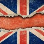 Grunge British flag on ripped paper — Stock Photo