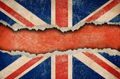 Grunge British flag on ripped paper — Stock Photo
