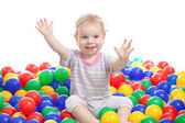 Hsppy boy playing colorful balls isolated on white — Stock Photo