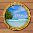 Stock Photo: Ship porthole with tropical island behind
