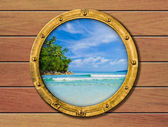 Ship porthole with tropical island behind — Stock Photo