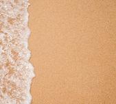 Water surf edge on beach sand — Stock Photo