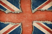 Ripped cardboard in form of British flag — Stock Photo