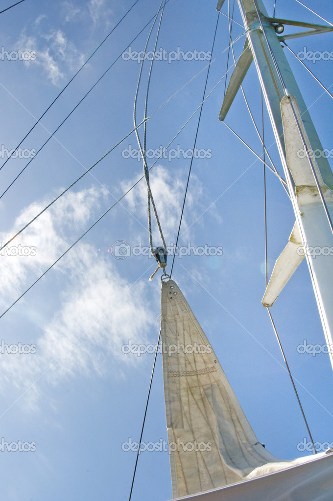 White yacht sails against the blue sky of tropical  Stock Photo #10947909