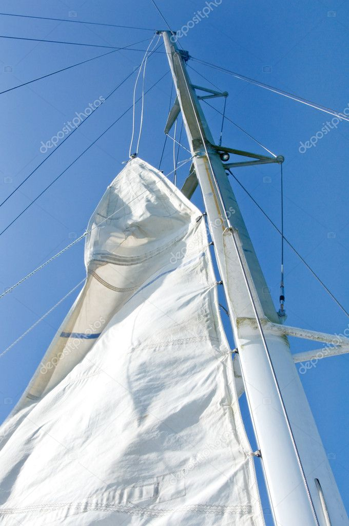 White yacht sails against the blue sky of tropical — Stock Photo #10948003