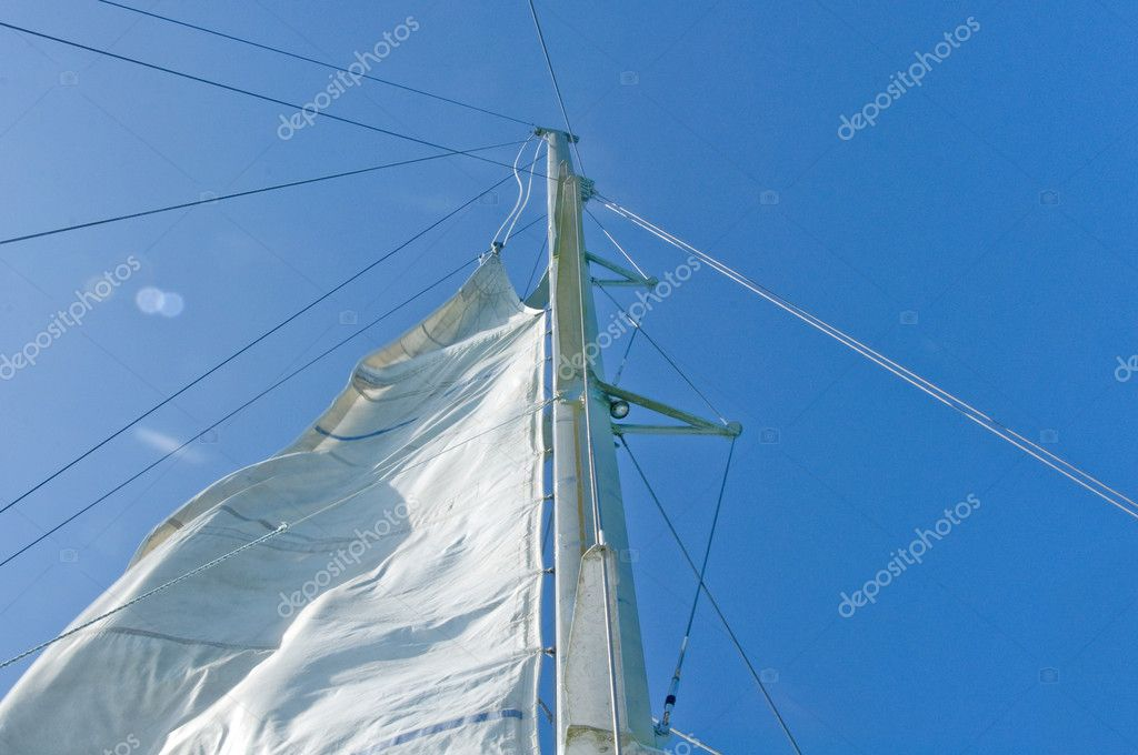 White yacht sails against the blue sky of tropical — Stock Photo #10948087
