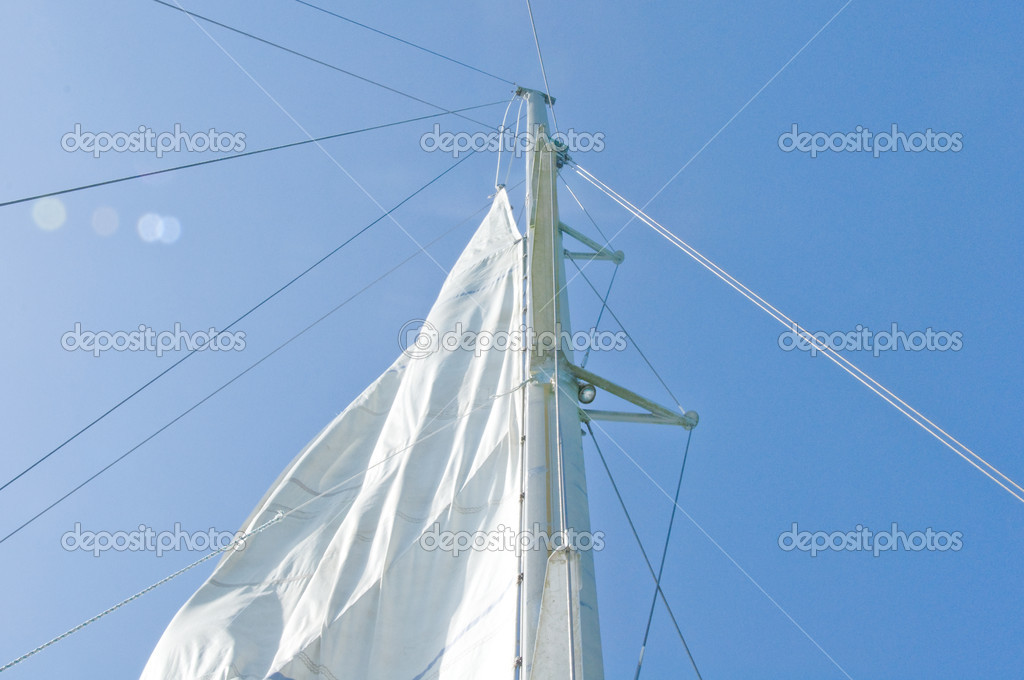 White yacht sails against the blue sky of tropical — Stock Photo #10948130
